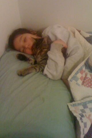 Lorelei in my bed with her kitten, Pepper.