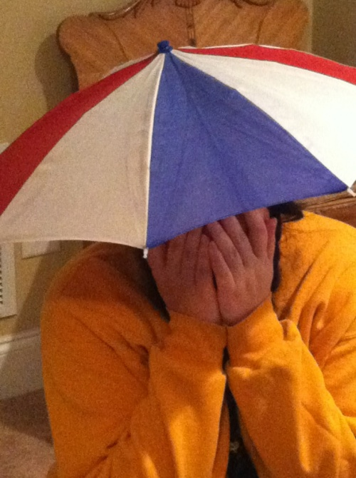 Emily models an umbrella hat